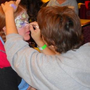 Elena painting Max